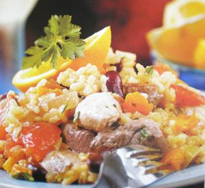 Paella con pollo e anatra all'arancia